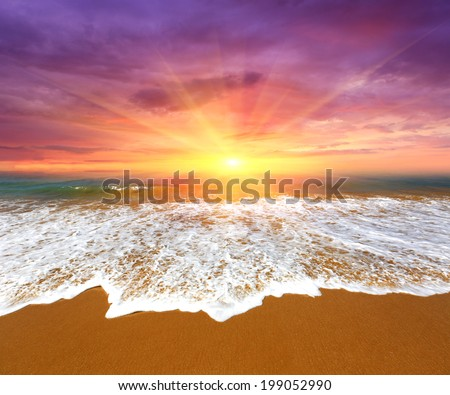 Nice majestic sunset over ocean beach - stock photo