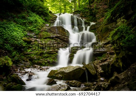 Nice majestic waterfall in forest