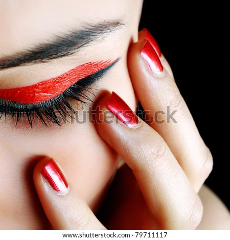nice manicure and a beautiful girl eye - stock photo