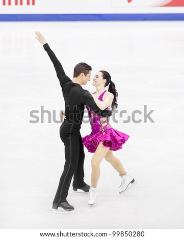 NICE - MARCH 28: Tessa Virtue and Scott Moir of Canada perform their short dance at the ISU World Figure Skating Championships on March 28, 2012 in Nice, France - stock photo