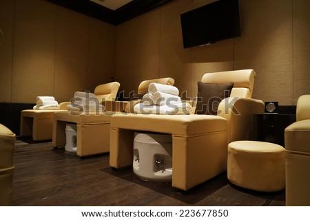 Nice massage room in spa saloon interior. - stock photo