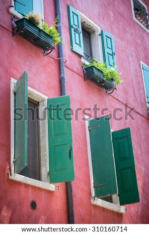 Nice mediterranean house facades with shutters and  different colours - stock photo