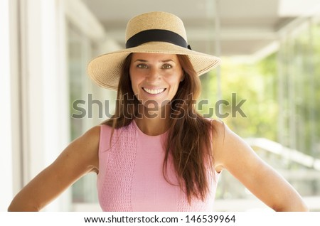 nice middle age lady with long hair and wearing a hat - stock photo