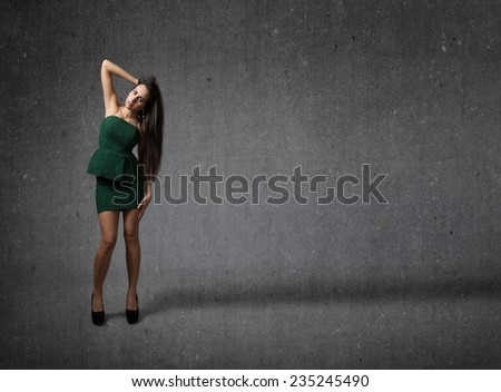 nice model standing in a gray abstract background - stock photo
