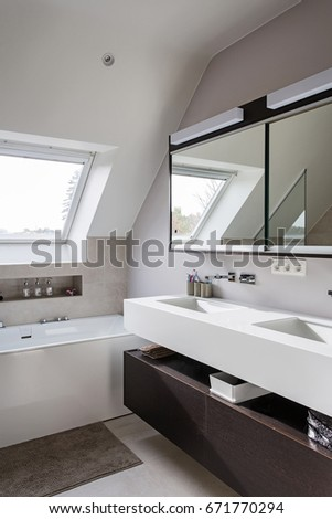 nice modern bathroom with freestanding bath  solid surface tablet and big walk in shower Nice Modern Bathroom Freestanding Bath Solid Stock Photo 671770297