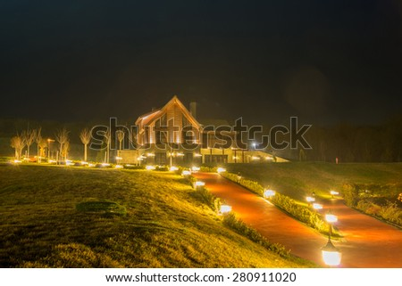 Nice modern house during evening hours - stock photo