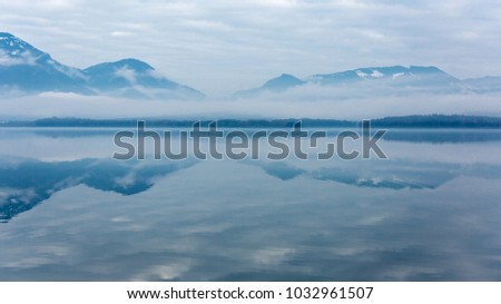 Nice morning misty scene with mountain lake