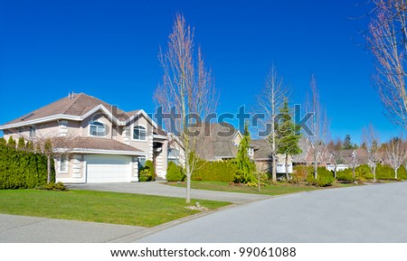 Nice neighborhood. A few homes  in suburbs in the north America. - stock photo
