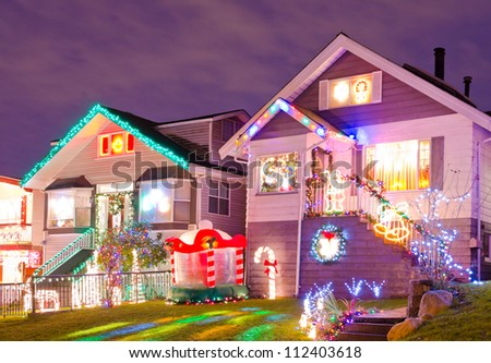 Nice neighborhood decorated and lighted for Christmas and for New Year Eve at Night at Vancouver, Canada. - stock photo