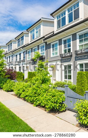 Nice neighborhood on a sunny day. Townhouses in the suburbs of the North America. Canada.