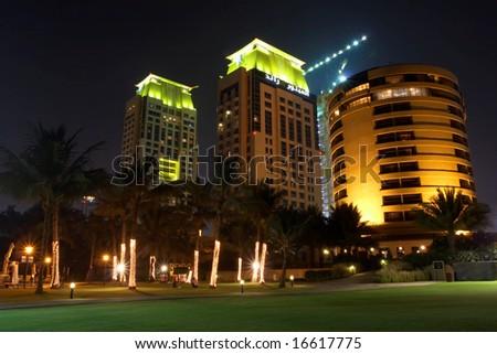 Nice night view of Dubai skyline with lit skyscrapers - stock photo