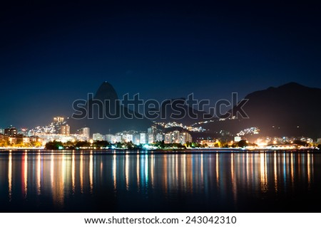 Nice Night View of Mountains and City Lights of Rio de Janeiro near Rodrigo de Freitas Lagoon - stock photo