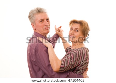 nice old couple dancing on a white