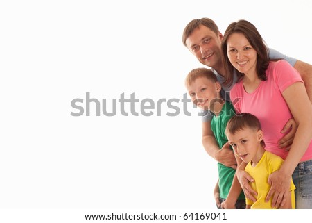 nice parents with their two children together on a white