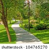 Nice park in the city with trees - stock photo