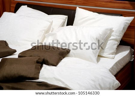Nice pillows on a contemporary bed