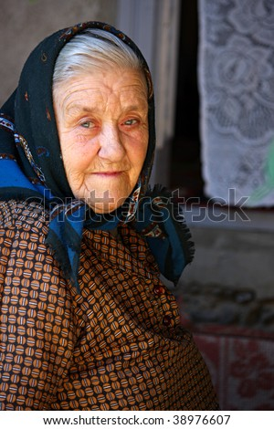 Nice portrait of an old woman - stock photo