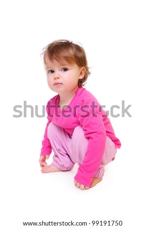 nice quiet child sitting on his haunches. isolated on white - stock photo