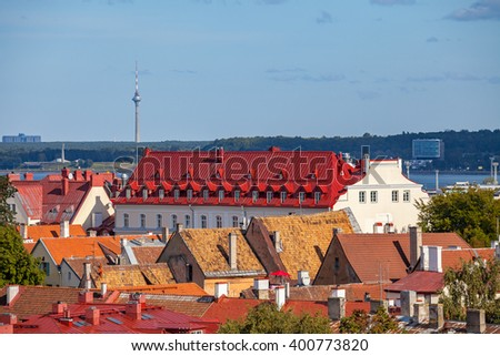 Nice red roofs of old Tallinn and TV tower at the background - stock photo