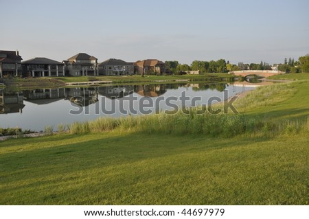 nice residential area with lakeview - stock photo
