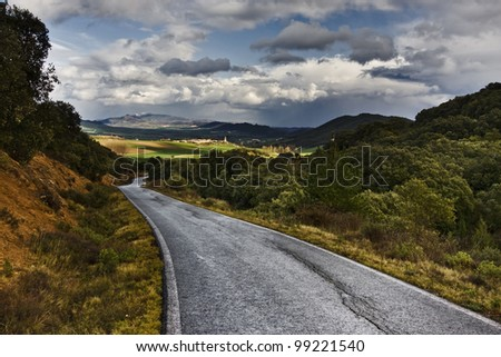 Nice road to valley and clouds - stock photo