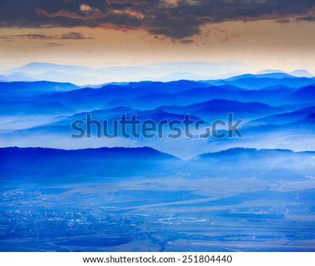 Nice scene with blue mountain's valley - stock photo
