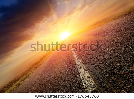 nice scene with road to sunset - stock photo