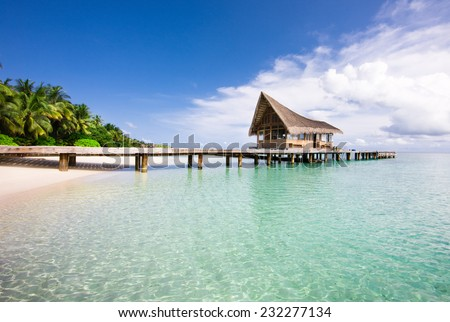 Nice scenery over beach with the water villas, Maldives - stock photo