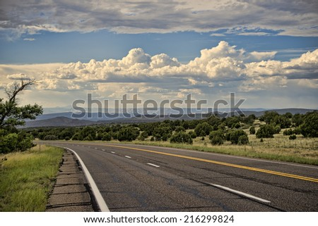 Nice scenic along Arizona highway, lots of clouds during monsoon season, August - stock photo