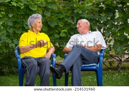 Nice senior couple together in a summer park - stock photo