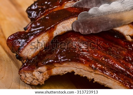 nice serving of bbq ribs on cutting board