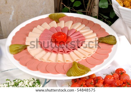 nice setup salami and ham - stock photo