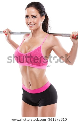 Nice sexy woman doing squat workout with big dumbbell over white background, retouched