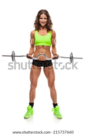 Nice sexy woman doing workout with big dumbbell isolated over white background (retouched) - stock photo