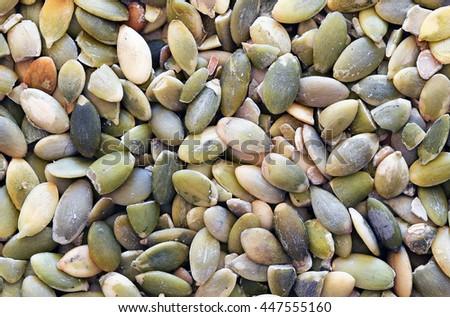 Nice shelled pumpkin seeds macro photo - stock photo