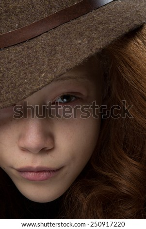 Nice shot of unique looking african american mixed race girl with striking red hair wearing a fedora hat - stock photo