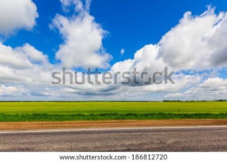 Nice Sky, green field and road landscape