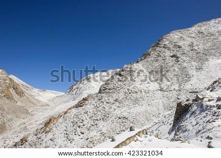 Nice sky with snow hill at Leh Ladakh India - stock photo