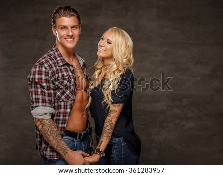 Nice smiling couple of athletic man and slim blond woman.