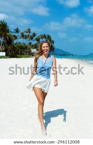 Nice smiling happy woman outdoor summer portrait walking on the beach having fun on vacation on tropic island