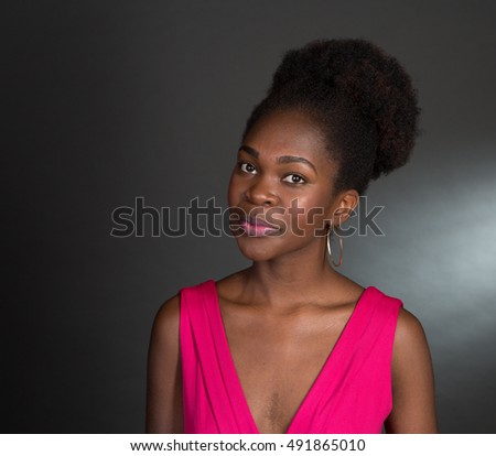 Nice Studio shot of a 20 year old African American girl with a pink dress