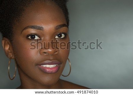 Nice Studio shot of a 20 year old African American girl with bare shoulders on a black background