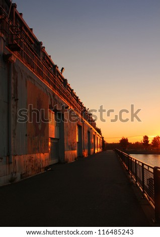 Nice sun on old rusty door at the pier in the old port of Montreal, Quebec by a nice early autumn morning
