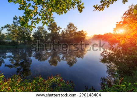 Nice sunrise landscape over river with morning fog