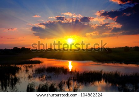 Nice sunset over river - stock photo