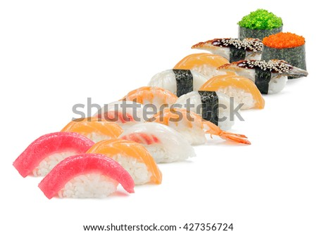 Nice sushi set in the accurate rows. Different types of tops on the rice. Tasty tuna, salmon, perch and eel as a seafood. Isolated. - stock photo