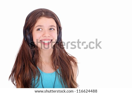 Nice teen girl listening to music with headphones