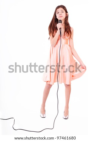 Nice teen girl with microphone, singing
