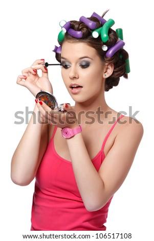 nice teenager doing her makeup - stock photo
