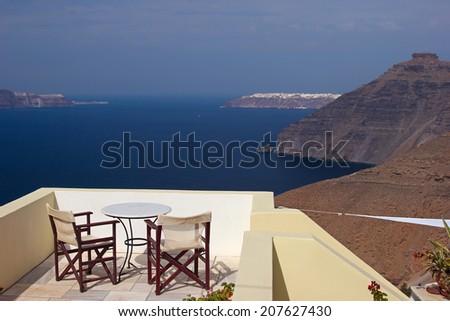 Nice terrace with the view over caldera in Santorini island, Greece - stock photo